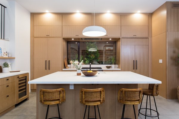 Modern home with kitchen, wood cabinet, concrete floor, engineered quartz counter, pendant lighting, and recessed lighting. Photo 4 of Love Street Residence