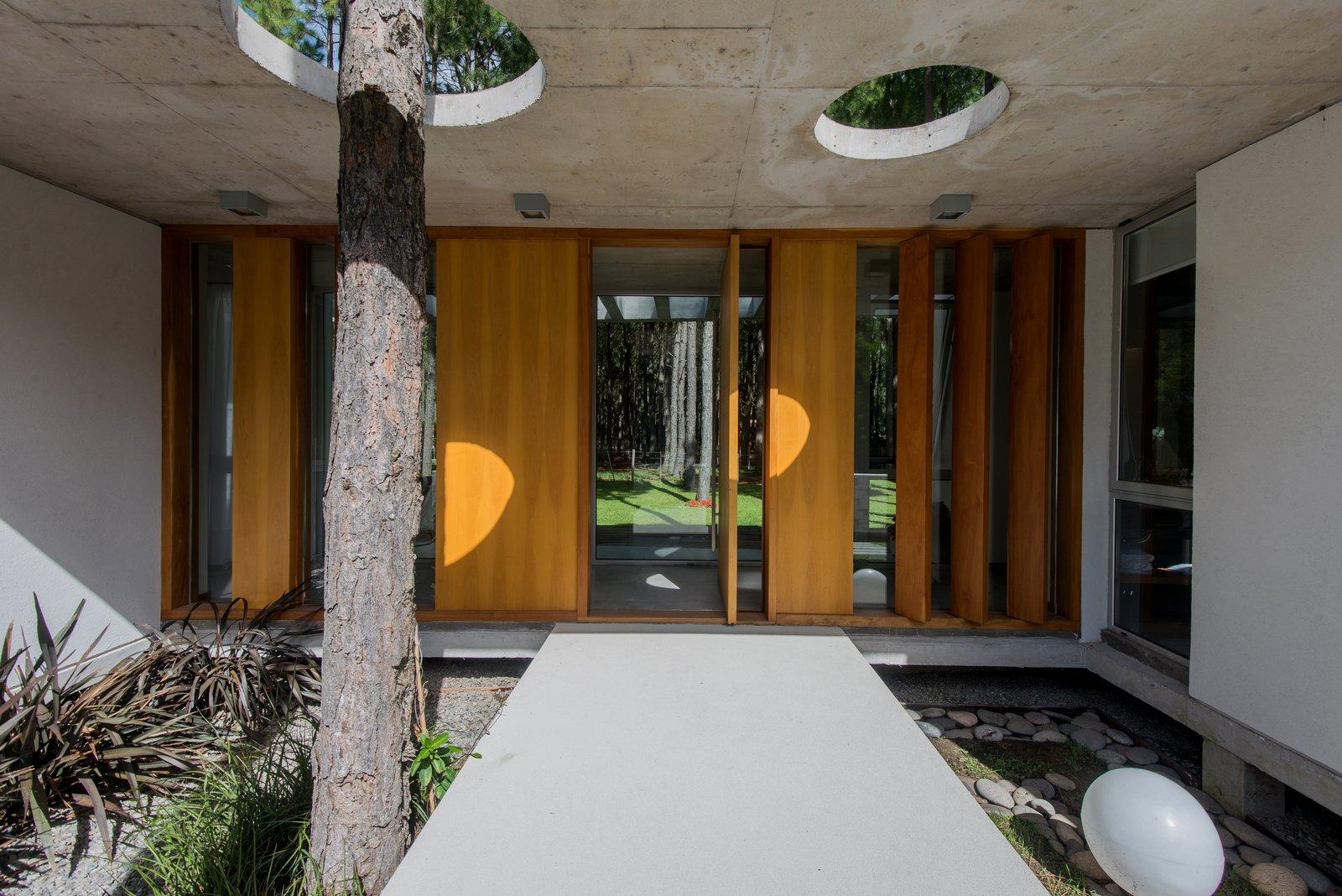 Tagged: Outdoor, Front Yard, Trees, Wood Patio, Porch, Deck, Concrete Patio, Porch, Deck, and Stone Patio, Porch, Deck.  Casa Batin by Estudio Galera