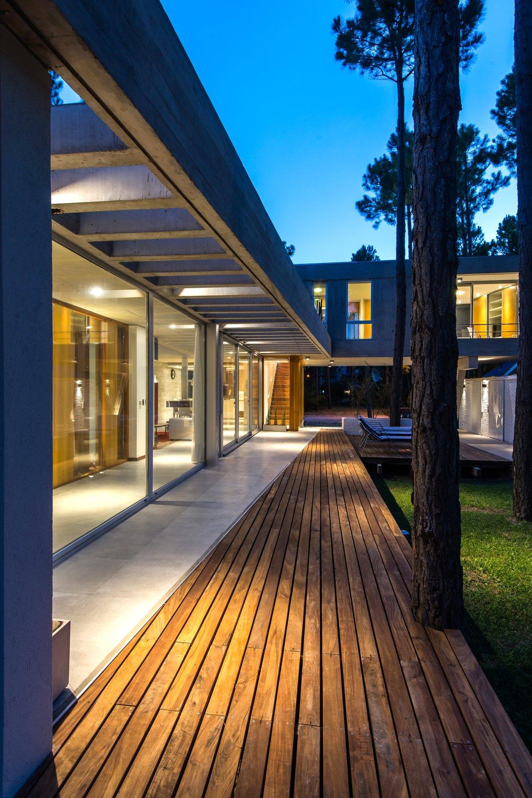 Tagged: Outdoor, Back Yard, Trees, Tile Patio, Porch, Deck, Decking Patio, Porch, Deck, and Wood Patio, Porch, Deck.  Casa Batin by Estudio Galera