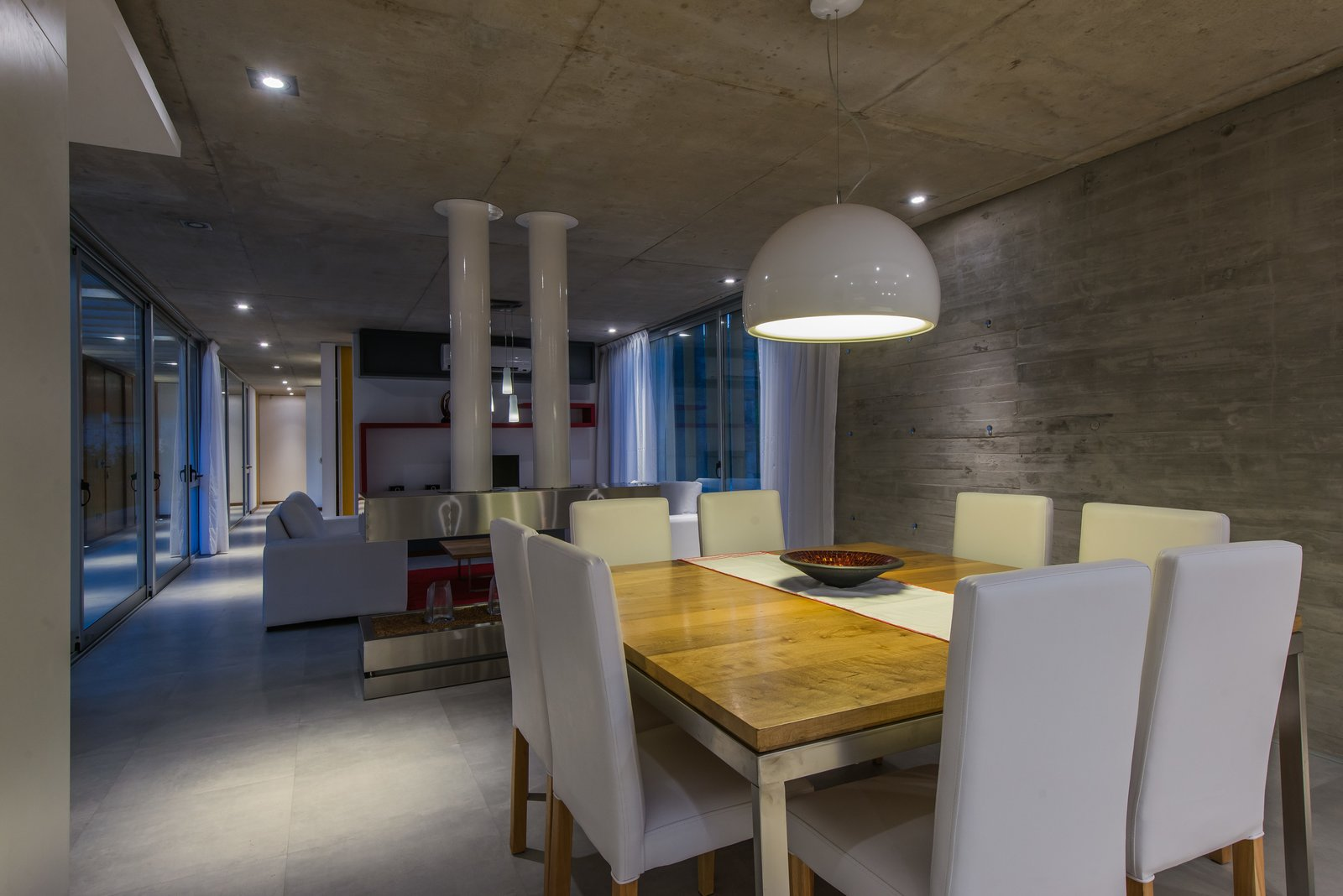 Tagged: Dining Room, Chair, Ceiling Lighting, Table Lighting, Porcelain Tile Floor, Table, and Standard Layout Fireplace.  Casa Batin by Estudio Galera