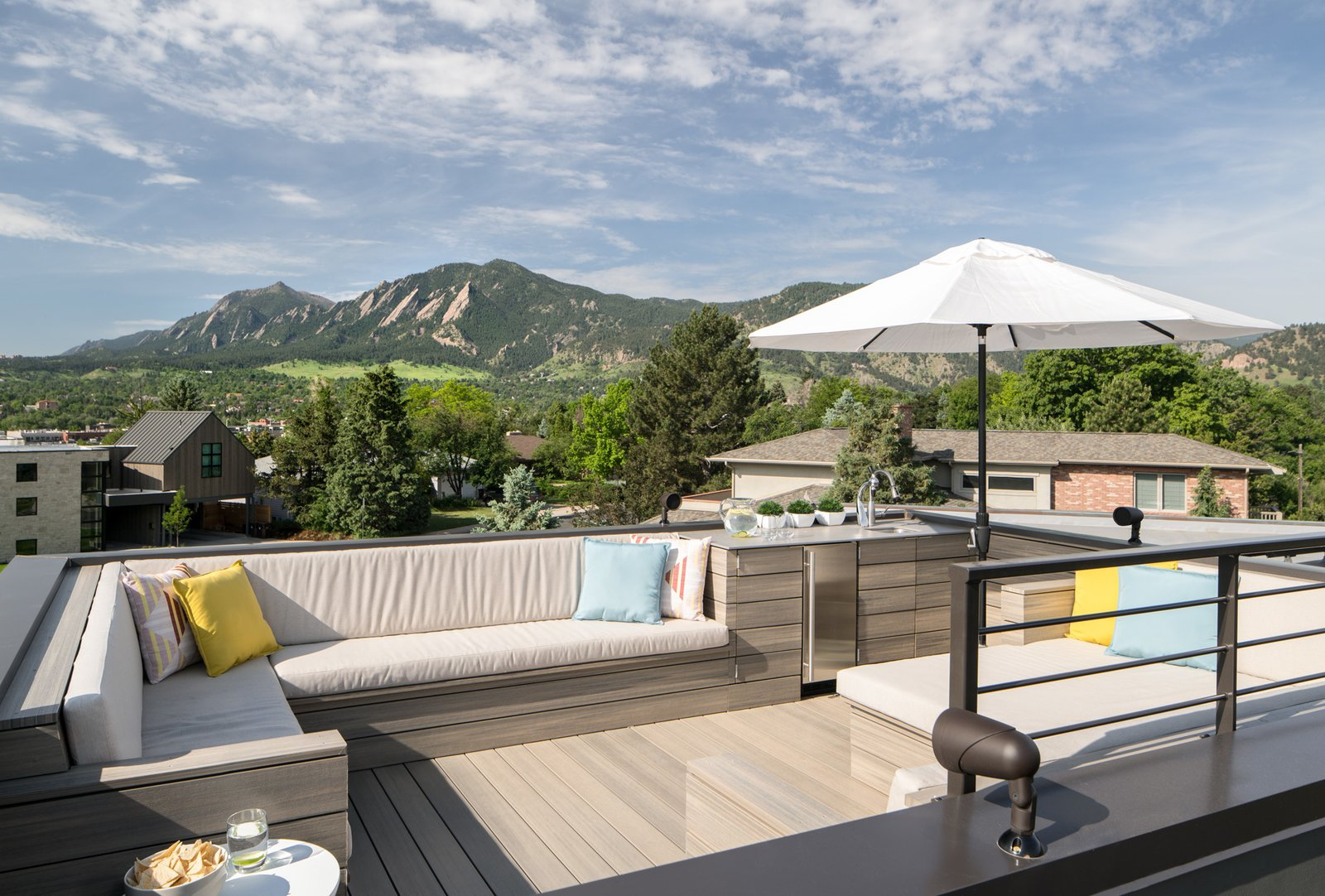 A rooftop deck provides 360-degree views of the Boulder Flatirons and the entire front range.