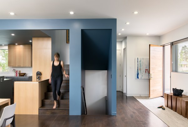 A blue ceiling and walls wrap around the kitchen and centrally located stair articulating the service side of the home.  Photo 6 of Sunset House modern home