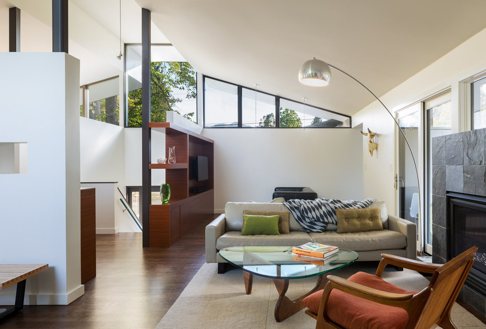 The living room was re-oriented to take advantage of indoor-outdoor living with large sliders and an indoor-outdoor fireplace. The space is now a well-used extension of the living area.  Tagged: Living Room, Chair, Sofa, and Coffee Tables.  Mid Century Re-Modern by HMHAI