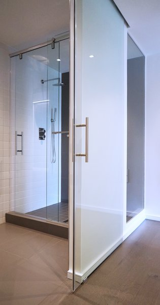 master shower with all glass wall and view to the outdoors Photo 3 of Duplex Apartment Gut Renovation modern home