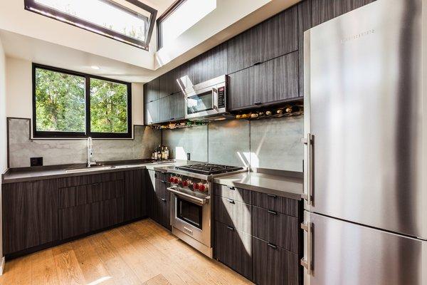 Clean Kitchen with Reclaimed Steel Backsplash Photo 5 of Reclaimed Malibu Modern modern home