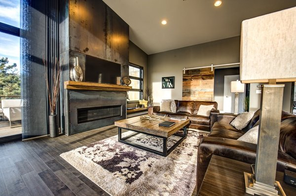"""The living room features a 60"""" linear gas fireplace and cold rolled steel fireplace cladding. Photo  of Ascent Estes Park modern home"""