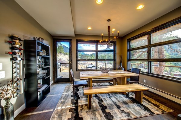 Dining set by Crate & Barrel.  All living areas enjoy stunning views of the surrounding front range of the Rockies. Photo 4 of Ascent Estes Park modern home