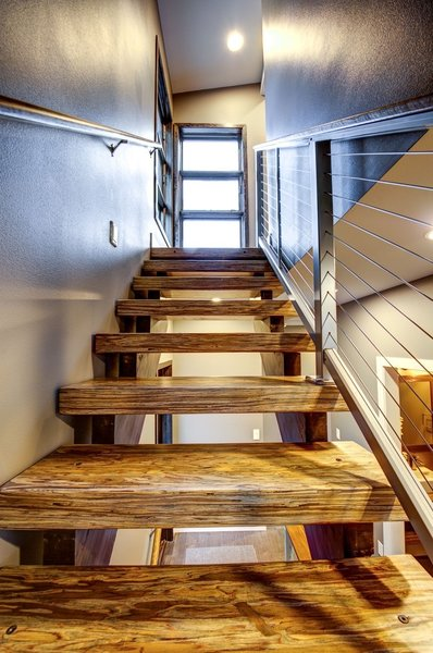 The homeowners also utilized the Parallam product for the stairway to the upper level. Photo 15 of Ascent Estes Park modern home