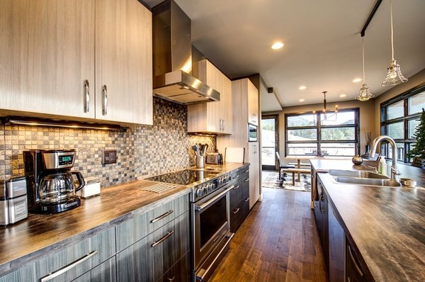Kitchen countertops are Formica.  Cabinets by Livia Cabinets of Denver. Photo 2 of Ascent Estes Park modern home