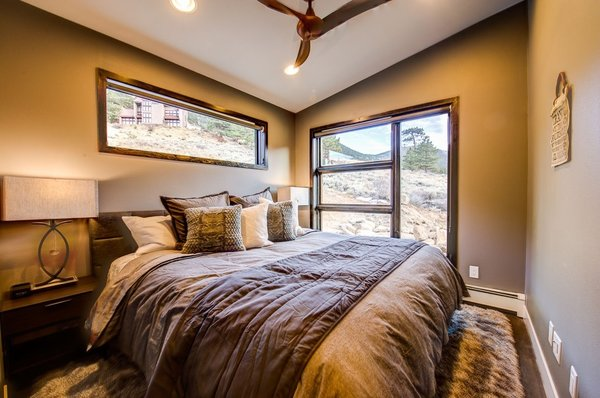 The main floor guest suite features endless up-valley views. Photo 6 of Ascent Estes Park modern home