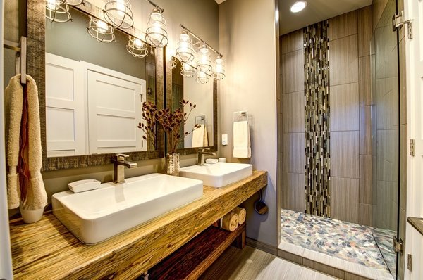 The guest suite bath features dual Kohler sinks, glass shower surround and stunning tile work. Photo 7 of Ascent Estes Park modern home