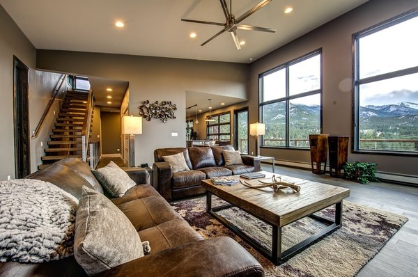 The living room features 14' ceilings, leather seating and a custom built Parallam coffee table. Photo 14 of Ascent Estes Park modern home
