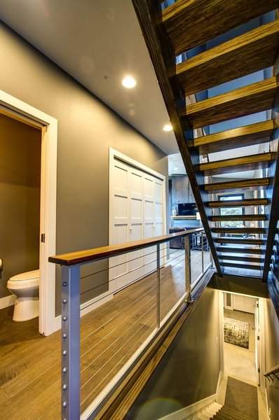 Stainless steel infill panels adorn the central stairways accessing all three levels of Ascent. Photo 9 of Ascent Estes Park modern home