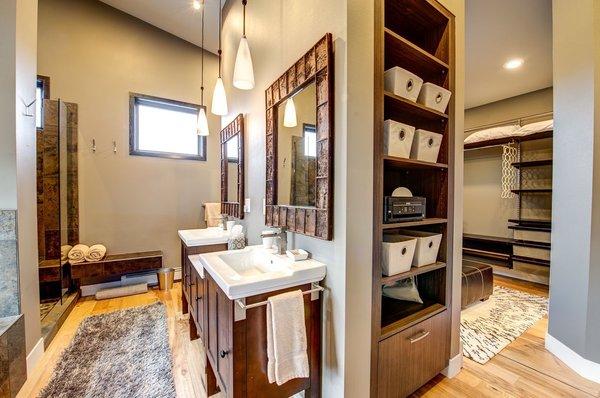 The master bath and closet continue Ascent's circulation theme. Photo 19 of Ascent Estes Park modern home
