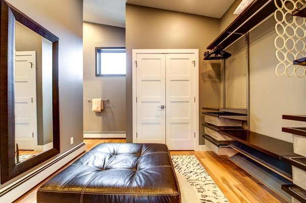 The master closet offers plenty of circulation space and natural light. Photo 16 of Ascent Estes Park modern home