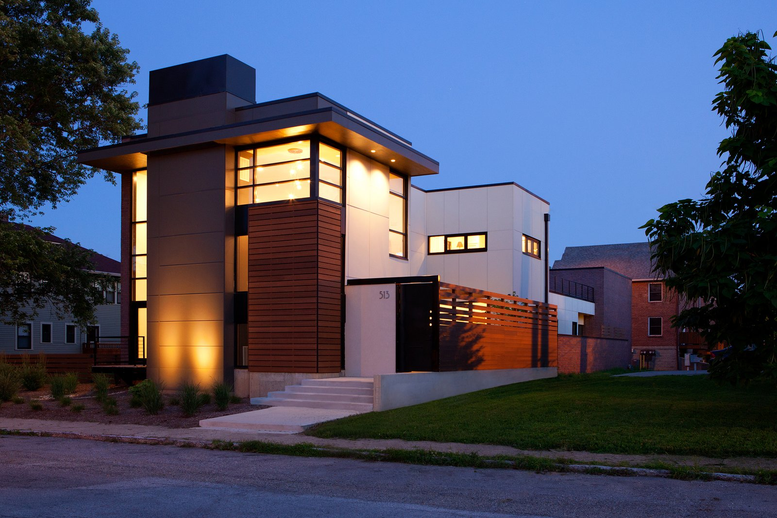 The design provides a layer of privacy for the homeowners, while the solid massing peels away to large expanses of glazing, framing intended view sheds both inward and outward. Along with its verticality, the home pulls key horizontal elements from the established neighborhood rhythm, specifically the eaves and elevated floor lines.