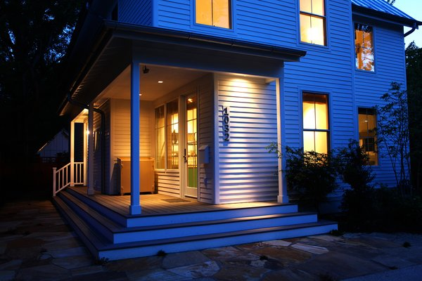 The home is entered from the street-facing front porch with an unexpected side-entry. Photo 2 of Urban Farmhouse modern home