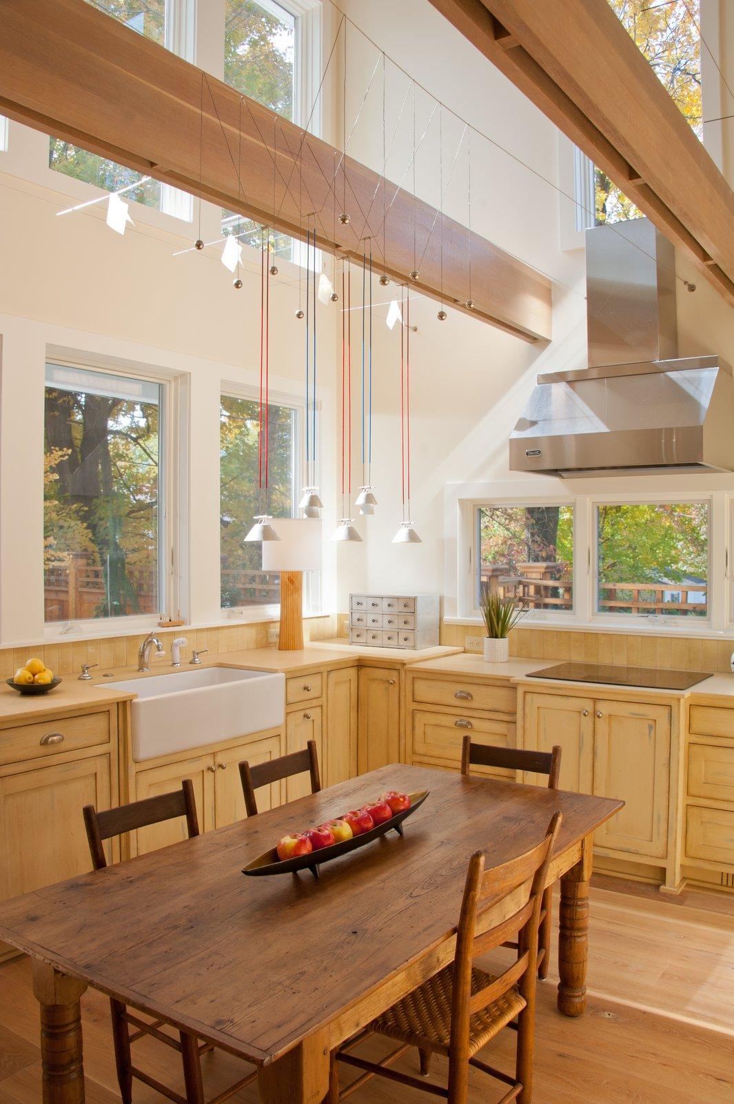 Tagged: Kitchen, Light Hardwood Floor, Undermount Sink, Cooktops, Pendant Lighting, Range Hood, and Wood Cabinet.  Urban Farmhouse by ONE 10 STUDIO Architects