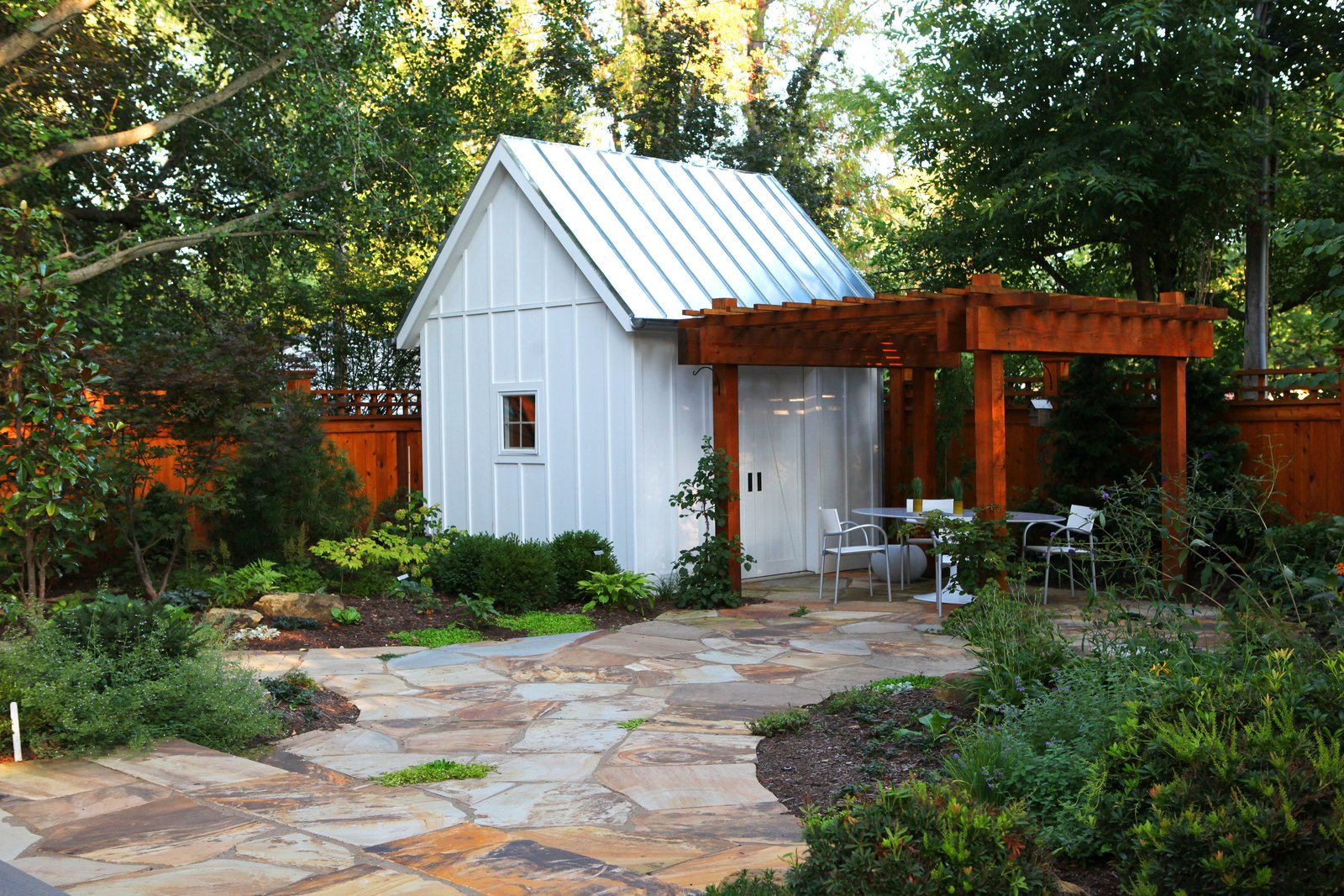 The Owner, a master gardener, desired a direct visual connection to the backyard, gardens, garden shed and pergola as an integral component of the design.  Urban Farmhouse by ONE 10 STUDIO Architects
