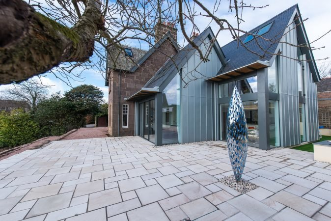 In 2016 Hyve Architects completed the renovation of The Gables, a heritage home in Stonehaven. A modern extension features an open kitchen and family room that connects to the main stone home. The double pitched roofline of the new structure references the end gable line of the original house.