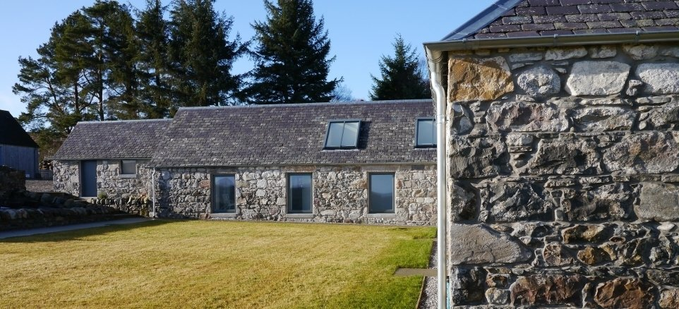 Finished in 2010, Glasgow-based Dualchas Architects converted a former L-shaped byre into a live-work space for a printmaker and textile designer. Interior concrete walls divide the working and living spaces, and new windows and skylights bring in additional light while preserving the original character of the structure.  Photo 8 of 11 in Merging Old and New With These 10 Modern Renovations in Scotland