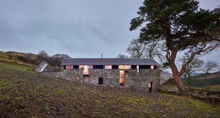 Merging Old and New With These 10 Modern Renovations in Scotland - Photo 9 of 10 - Another home by WT Architecture, The Mill is a former threshing mill that was transformed into a modern vacation home. Abandoned for 70 years prior to its renovation, the structure required significant work. The majority of the interior spaces are open-concept and lined with plywood and pine planks, and additional windows allow for views to the valley.
