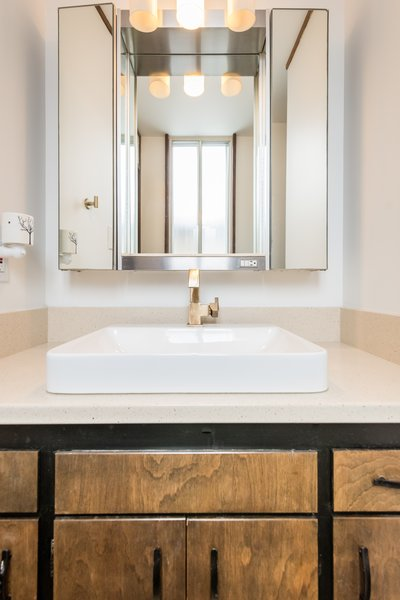 Slightly updated bath with champagne bronze hardware through out the home Photo 17 of Ron Molen Revival modern home