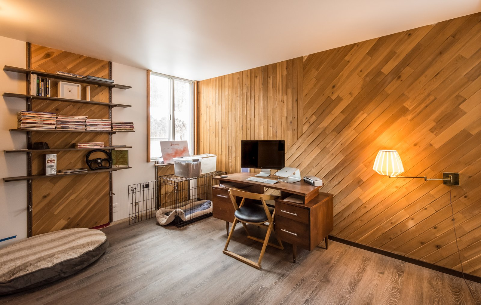 Office with original cedar wood accent wall Ron Molen Revival by The Muve Group