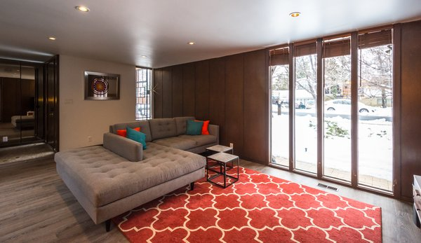 Front living room with double bumper chaise couch Photo 8 of Ron Molen Revival modern home