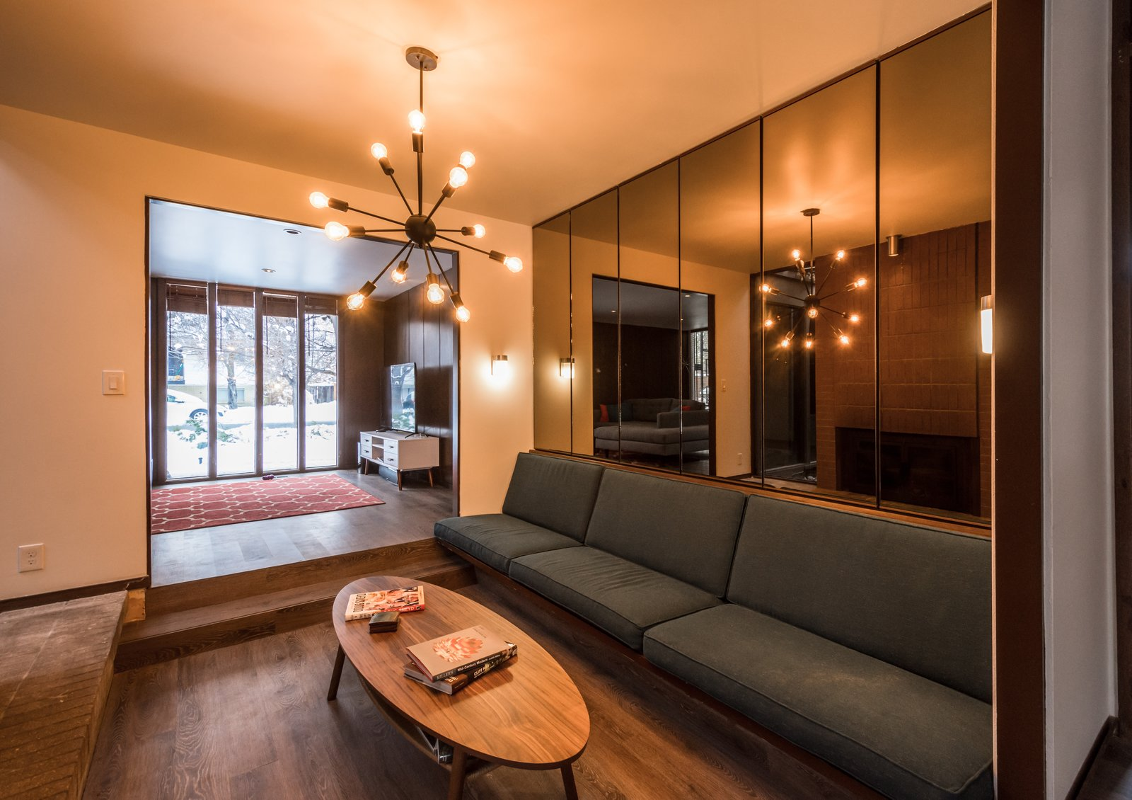 Conversation pit with smoke mirrors and sputnik light  Ron Molen Revival by The Muve Group