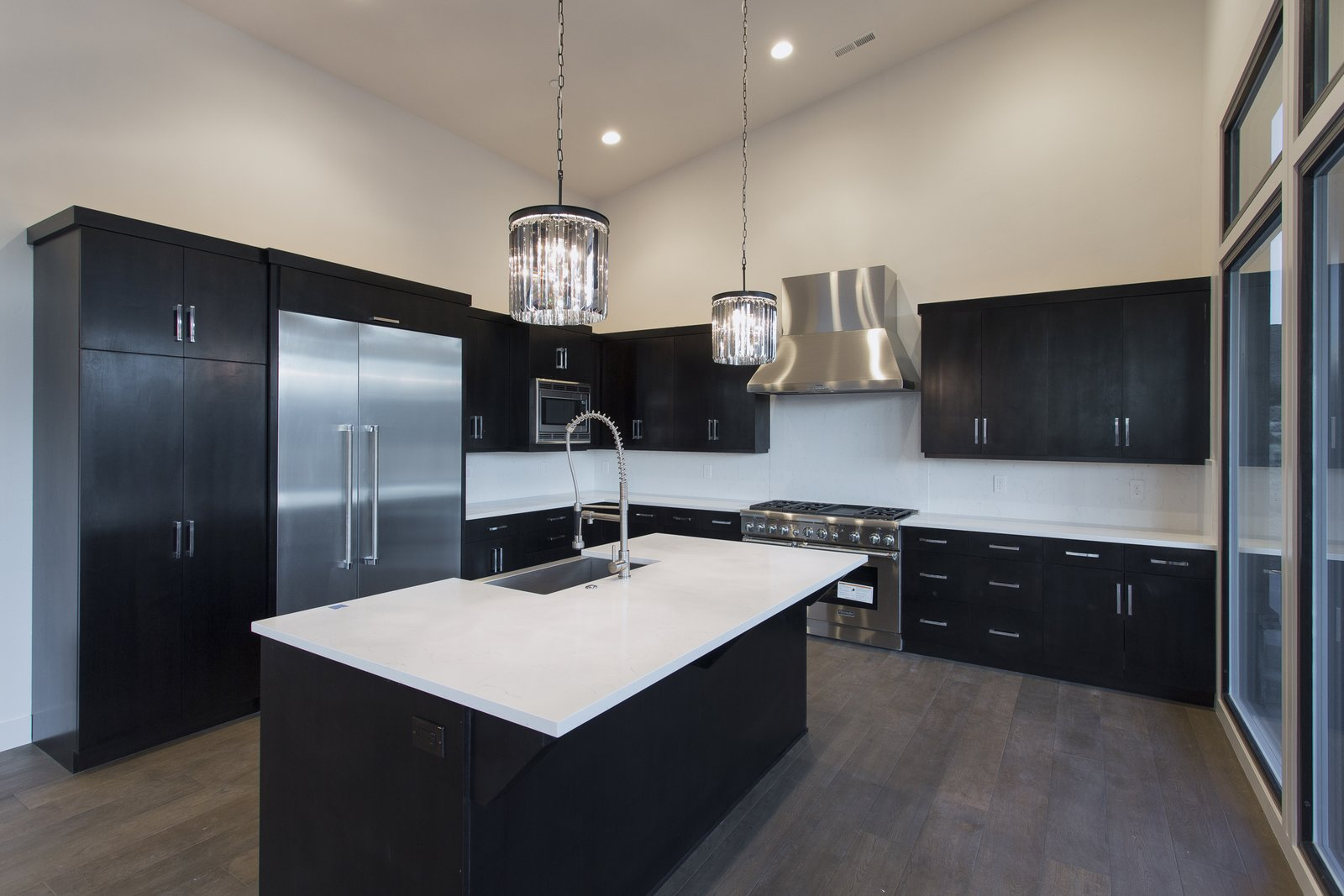Dark brown cabinets accented with white cabinets