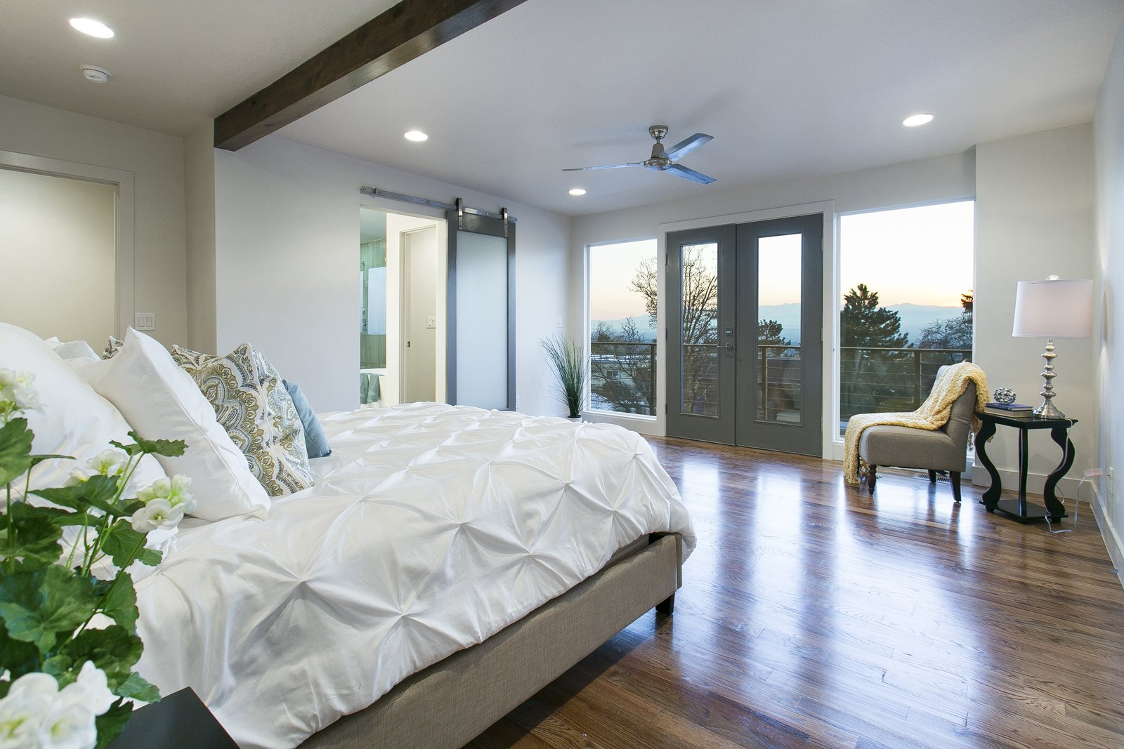 The master bedroom was thoughtfully laid out so you can take in the breathtaking views of the Salt Lake Valley each morning when you wake up.  King of the Wasatch by The Muve Group