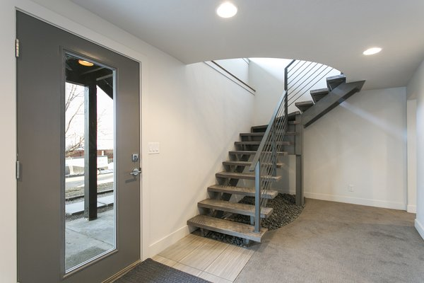 Floating staircase that leads to the walk out daylight basement. Photo 5 of King of the Wasatch modern home