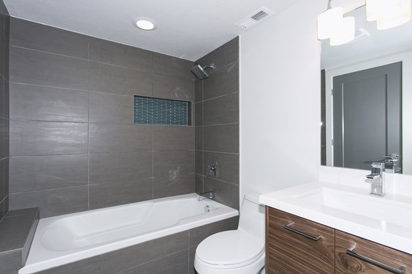 All baths have been updated with new horizontal straight lay tile with convenient storage nooks. Photo 7 of King of the Wasatch modern home