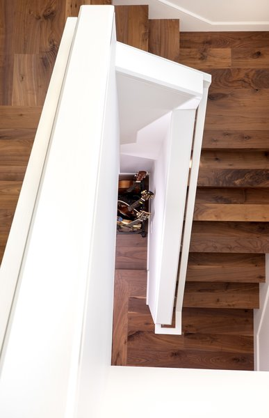 Stairwell leading to lower level of a two-story remodeled Cow Hollow home. Photo 5 of San Francisco, Cow Hollow Remodel modern home