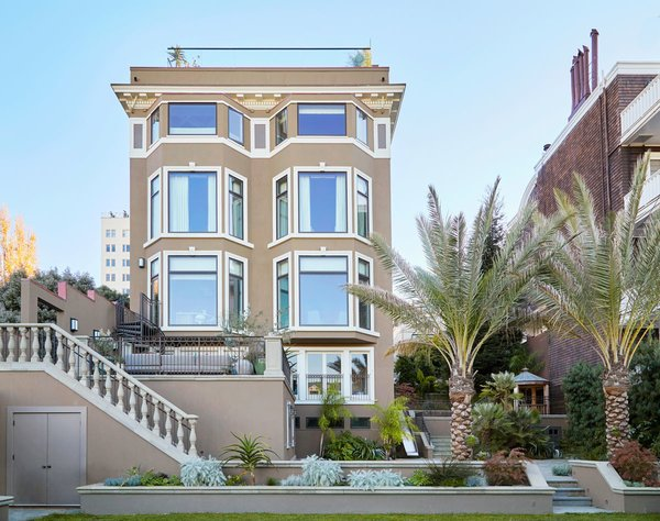 Prior to this project, the rear elevation was a tangled mess of odd sized windows and balconies that were never completed. We gave it symmetry and scale to compliment the orderliness of the rest of the house. Photo  of Pacific Heights Historic Renovation modern home