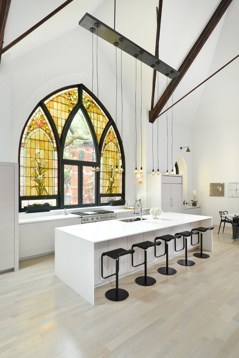 This church conversion in Chicago was completed by Linc Thelen Design and Scrafano Architects, and transformed the brick church into a single-family home. Arched stained glass windows were maintained, and some panels were swapped out for clear glass.  Photo 5 of 9 in 7 Repurposed Churches Around the World