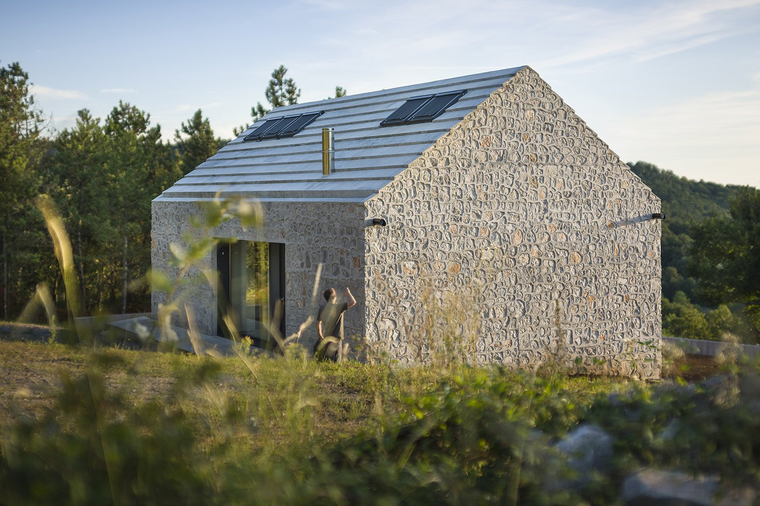 Compact Karst House by dekleva gregorič arhitekti Tagged: Exterior, Cabin Building Type, and Stone Siding Material.  Photo 5 of 16 in These 4 Modern Homes Around the World Take Advantage of Local Stone