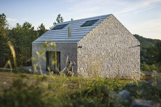 These 4 Modern Homes Around the World Take Advantage of Local Stone - Photo 5 of 16 - Compact Karst House by dekleva gregorič arhitekti