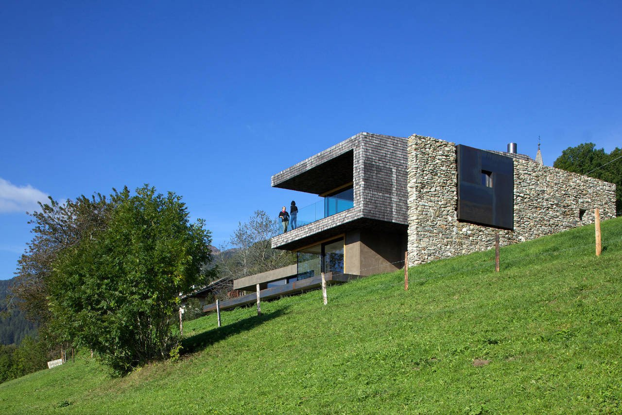 The home's location in Sterzing, Italy meant that it was surrounded by a rural green landscape, and the architects sought to change it as little as possible.  Photo 7 of 19 in Rising From the Ruins: Homes Built on Architectural Remains