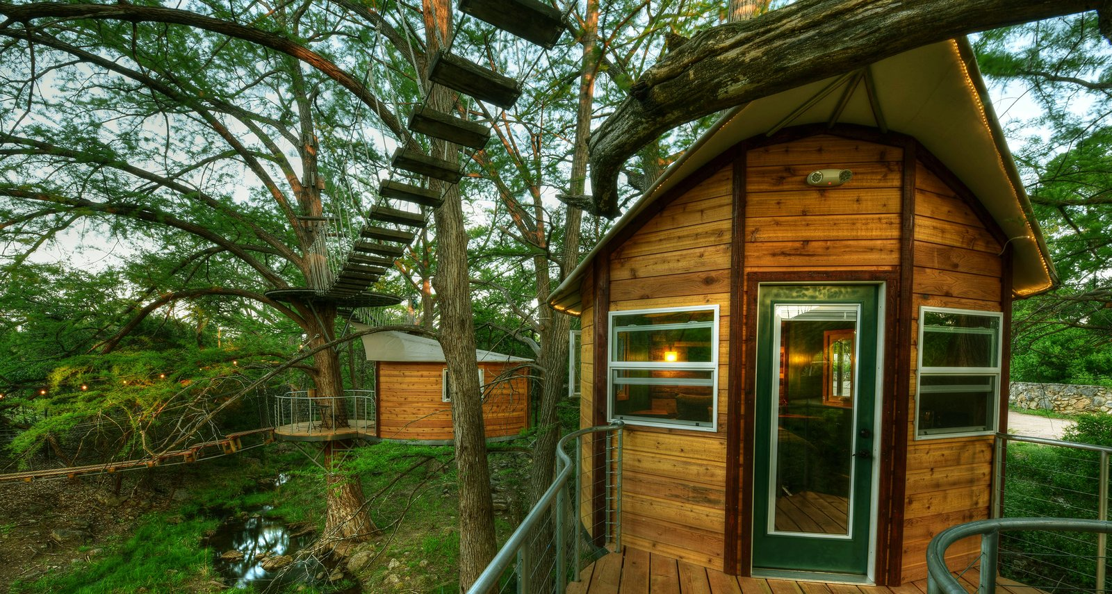The Willow & Juniper tree house by ArtisTree Tagged: Exterior, Wood Siding Material, and Treehouse Building Type.  Photo 3 of 16 in Experience Tree-Top Living at One of These Sustainable Tree Houses