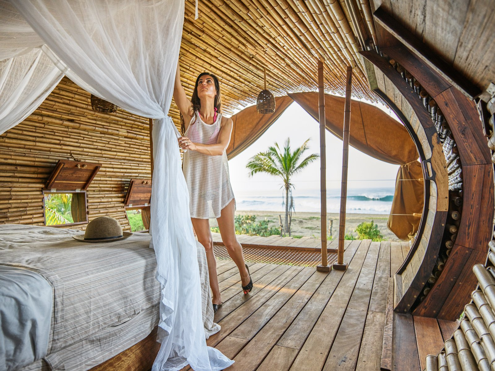 The Playa Viva tree house by ArtisTree Tagged: Bedroom, Bed, Medium Hardwood Floor, and Pendant Lighting.  Photo 14 of 16 in Experience Tree-Top Living at One of These Sustainable Tree Houses