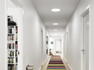 5 Architectural Tricks and Devices to Bring Natural Light Into Your Home - Photo 7 of 12 - A series of three sun tunnels, or sun pipes, brighten up a windowless corridor.