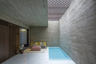 5 Striking Designs That Use Perforated Cement Breeze-Blocks in Interesting Ways - Photo 6 of 10 - The use of the two types of concrete continues throughout the project, both in the interior and exterior spaces.