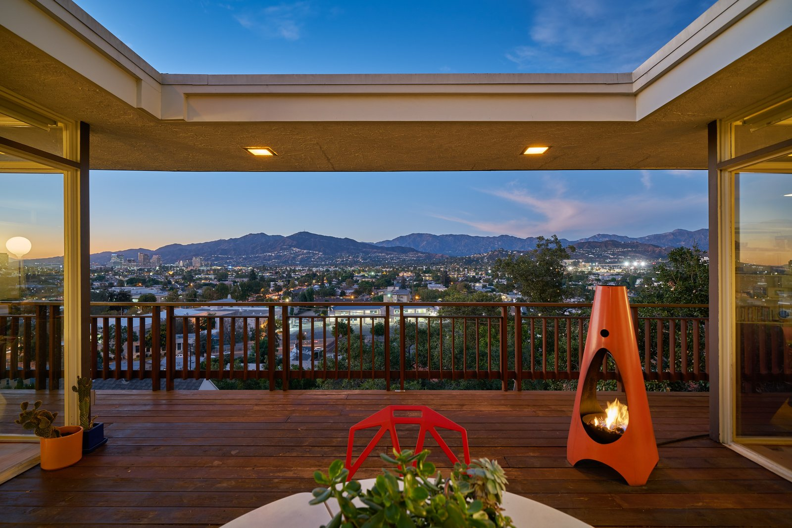 Beautiful vistas of the city are the centerpiece of this show-stopping home. Tagged: Outdoor and Wood Patio, Porch, Deck.  Photo 3 of 14 in A Midcentury-Modern Home in L.A. Designed by Richard Banta Is For Sale For $899K