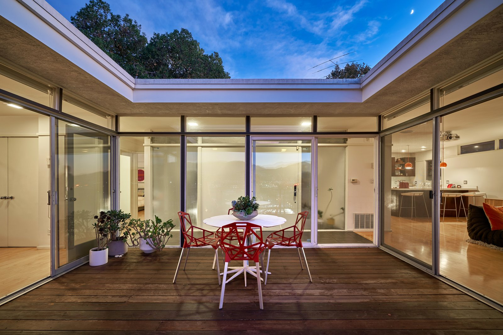 The patio is open to the sky above, allowing for light to flood the rooms that surround it. Tagged: Outdoor and Wood Patio, Porch, Deck.  Photo 5 of 14 in A Midcentury-Modern Home in L.A. Designed by Richard Banta Is For Sale For $899K