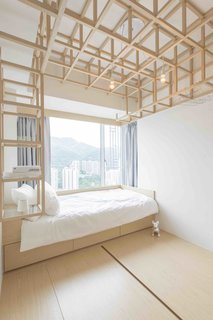 8 Japanese-Inspired Spaces We Love - Photo 8 of 8 - In Hong Kong, where real estate is at a premium, elegant storage solutions inspired by Japanese mobile cabinetry were a starting point for local practice MNB Design Studio. With an eye towards the structure and folded joints of origami, the designers created an open wooden framework of hollowed spaces that create flexible and open storage for clothing.