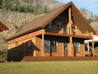 """7 Prefab Companies That Oregon Dwellers Should Know - Photo 1 of 7 - At 939 square feet on the main floor, the """"Get-Away"""" cabin by TLC Modular Homes also features about 150 square feet of an outdoor covered deck and a lofted second floor. TLC Modular Homes, while based in Goldendale, Washington, services areas in both Oregon and Washington state, and they offer modular homes that vary from more traditional styles like Cape Cod homes to smaller, rustic cabins, all made in their proprietary factory that opened in 2000."""
