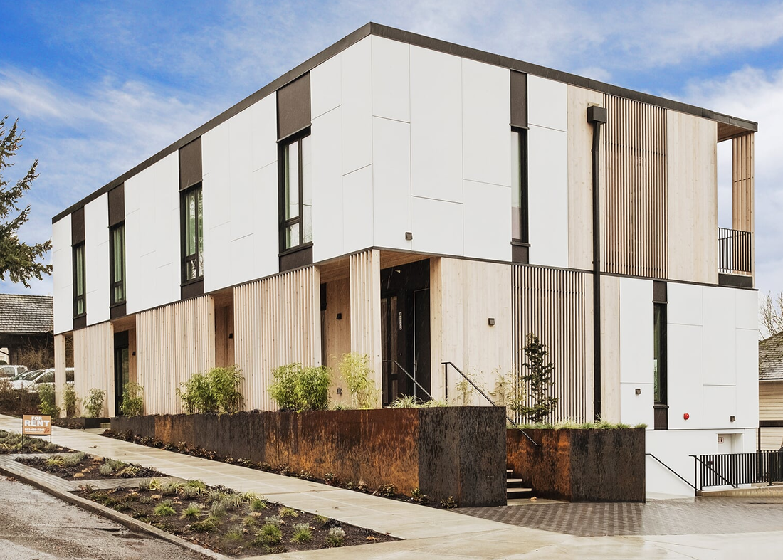 Based in Portland, Oregon, MODSpdx is a West Coast builder with a holistic approach to customized and site-specific modular multi-family and commercial buildings. Buildings are constructed in their Portland factory, with a focus on proper ventilation and thermodynamics for the finished product through tight factory controls and an analysis of repeatable processes. Because the company works with a range of general contractors, architects, construction companies, and residential developers, their finished homes vary in aesthetics from traditional to contemporary. Tagged: Exterior, Prefab Building Type, Apartment, Metal Siding Material, Wood Siding Material, and Flat RoofLine.  Photo 4 of 7 in 7 Prefab Companies That Oregon Dwellers Should Know