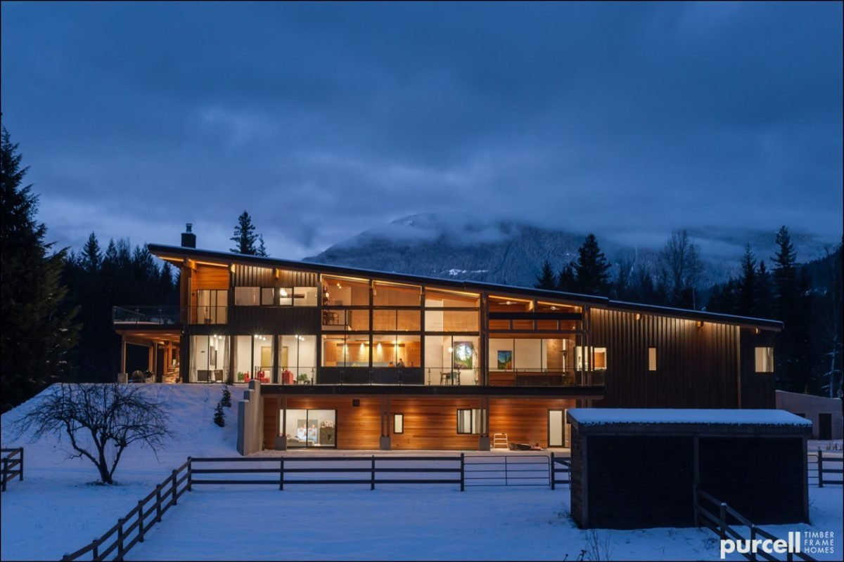 Purcell Timber Frame Homes is, as they say, a product of their environment: the beautiful Kootenay mountains of Nelson, British Columbia. They've developed a strong relationship with the local forests, and build prefabricated, packaged, and fully-customized homes in British Columbia and Alberta, Canada as well as several states in the Pacific Northwest, including Oregon. Their homes feature natural timber frames, and their catalogue collection includes bungalows, beach houses, ski chalets, cabins, and cottages that are designed to perform with the elements and be low-maintenance. Tagged: Exterior, Wood Siding Material, Metal Siding Material, House, and Prefab Building Type.  Photo 3 of 7 in 7 Prefab Companies That Oregon Dwellers Should Know